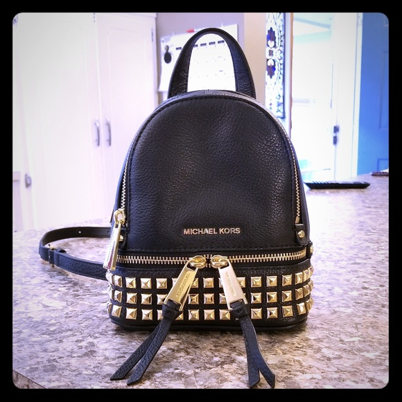 1926607c8592 Michael Kors Rhea Mini Studded Backpack. M 5b379740fe5151fb724a4b7f